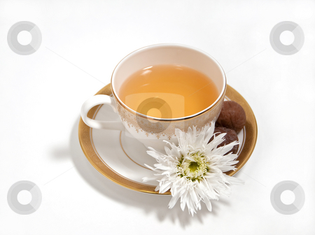 A cup of tea stock photo, Tea with chocolate truffles and white daisy by Shi Liu