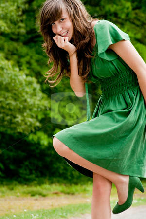 Sweet girl in a green dress stock photo, Young fashionable girl in a happy mood by Frenk and Danielle Kaufmann