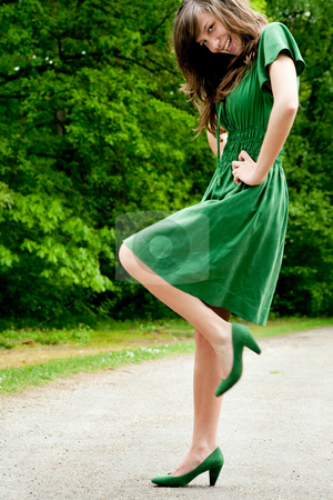 Young fashion green pose stock photo, Young fashionable girl in a happy mood by Frenk and Danielle Kaufmann