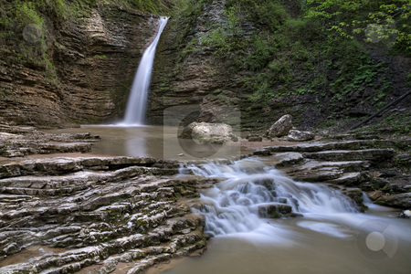 Waterfalls on a mountain river stock photo, small cascade of waterfalls on a mountain river by Valery Kraynov