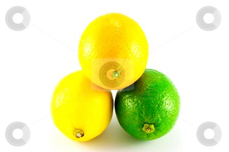 Lemon, Lime and Orange stock photo, Single whole lemon, Lime and Orange on a white background by Keith Wilson