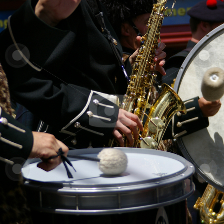 Sax and Drums stock photo, Saxophone and drums as part of a marching band. by Tom Weatherhead