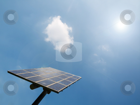 Solar panel stock photo, Solar panel under blue sky with sun flare by Laurent Dambies