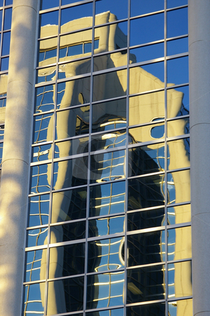 Refleted Building stock photo, A concert and glass building reflected in another concert and glass building. by Tom Weatherhead