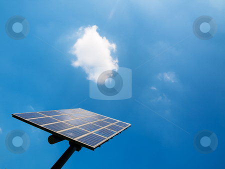 Solar panel stock photo, Solar panel under blue sky with clouds by Laurent Dambies