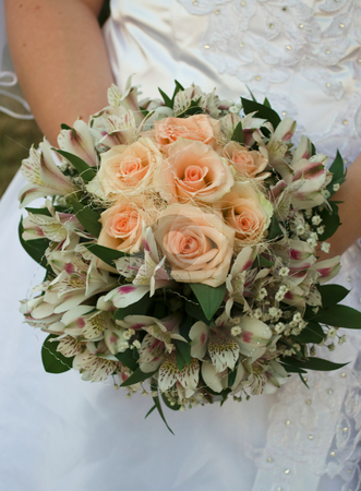 Wedding bouquet stock photo, Wedding bouquet with roses in bride's hands by Desislava Dimitrova