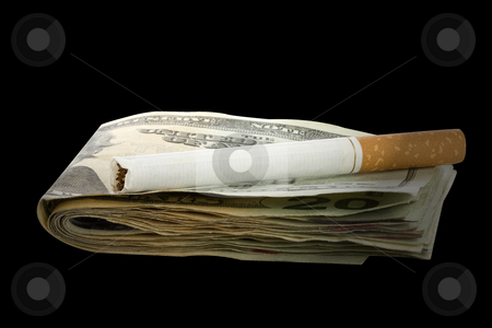 Cigarette on money stack stock photo, Cigarette on a money stack with black background by Chris Roselli