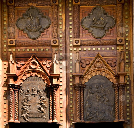 Wooden Church Doors Mexico stock photo, Wooden Church Doors with Metal Religious and Mexican Symbols and Decorations, Temple Expiatorio, Temple of Atonement, Guadalajara, Mexico by William Perry