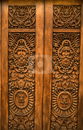 Wooden Carved Door Guadalajara Mexico stock photo, Wooden Brown Carved Door with symbols of Mexico Guadalajara Mexico by William Perry