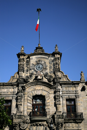 Government Palace Guadalajara Mexico stock photo, Government Palace with Clock Tower and Flag, Guadalajara, Mexico  This is a very old Spanish style building. by William Perry