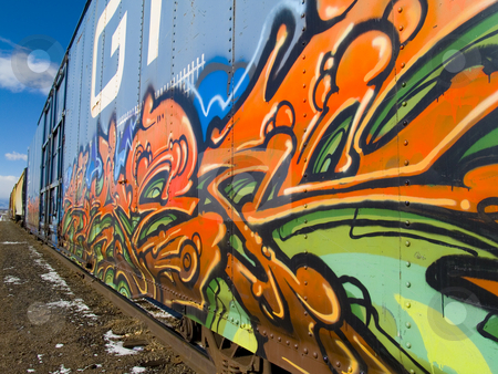 Graffiti stock photo, Vibrant vandalism on a train box car by Cora Reed
