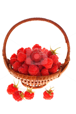 Raspberry stock photo, Wicker full of raspberries  on white background by Jolanta Dabrowska
