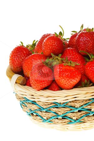 Strawberries stock photo, Ripe strawberries in wicker on white background by Jolanta Dabrowska