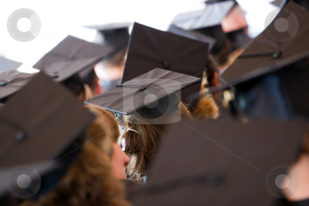 Group of Graduates stock photo, A group of college or high school graduates wearing the traditional cap and gown.  Shallow depth of field. by Todd Arena
