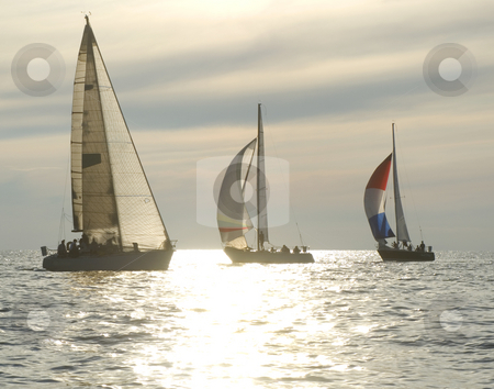 Sunset yacht race stock photo, Sailboats rounding a mark in a sunset race by Jonathan Hull