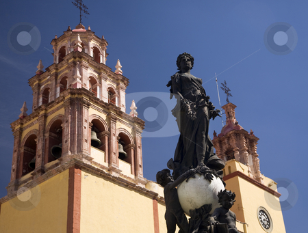 Peace Statue Basilica Guanajuato Mexico  stock photo, Peace Statue Donated To City by Charles V, Holy Roman Emperor, in the 1500s, Steeple, Towers, Bells, Basilica of our Lady of Guanajuato, Basilica de Nusetra Senora Guanajuato, Mexico by William Perry