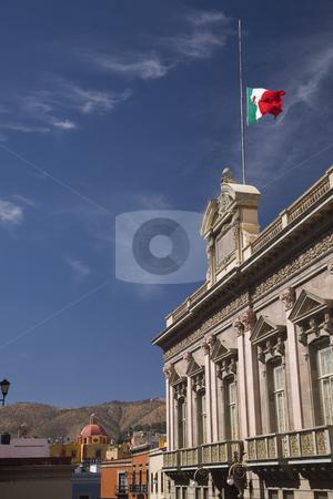 Government Building Church Flag Guanajuato Mexico stock photo, Government Building Church, Street, Flag, Guanajuato Mexico, Blue Sky by William Perry