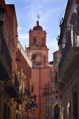 San Francisco Pink Church End of Street Guanajuato Mexico stock photo, Templo de San Francisco, San Francisco Church, Guanajuato, Mexico, Built in the 18th Century of Pink Stone at the end of street under blue sky by William Perry