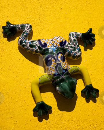 Mexican Ceramic Frog Yellow Wall Mexico stock photo, Mexican Ceramic Frog, Yellow Wall, Guanajuato, Mexico.  Guanajuato is known as the Frogs Place for the mountains around the city that look like frogs. by William Perry