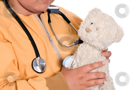 Stuffed Animal Care stock photo, Closeup of a young girl holding a stuffed bear while wearing a stethoscope, isolated against a white background by Richard Nelson