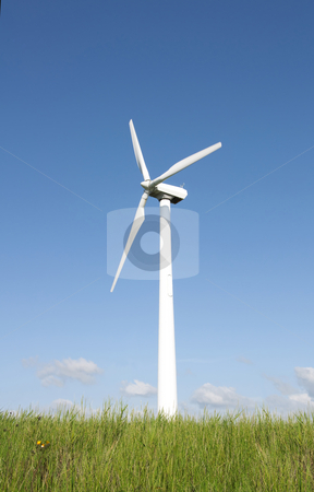 Wind turbine  stock photo, Wind turbine on a grassy hill by Jesper Klausen