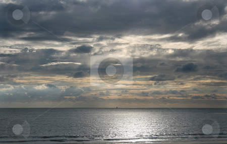 Horizon boat stock photo, Sun on the beach with a boat in the horizon by Marc Torrell
