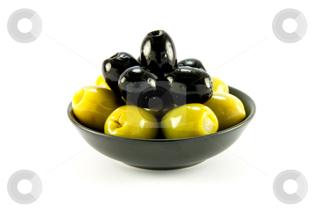 Green and Black Olives in a Bowl stock photo, Green and black olives in a small black bowl on a white background by Keith Wilson