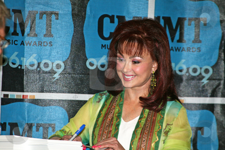 Naomi Judd - CMA Music Festival 2009 stock photo, Naomi Judd at the CMA Festival June 11-14, 2009 in Nashville, Tennessee signing autographs by Dennis Crumrin