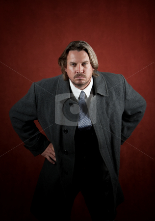 Aggressive Businessman stock photo, Aggressive businessman leaning in towards the camera by Scott Griessel