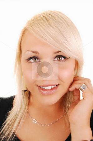 Pretty blond girl. stock photo, Portrait of a very beautiful blond woman in a black dress, holding her left hand on the ear and smiling in the camera. For white background. by Horst Petzold