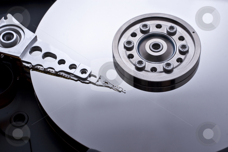Hard drive inside details stock photo, Closeup and macro view of hard drive inside by Kenneth Ro