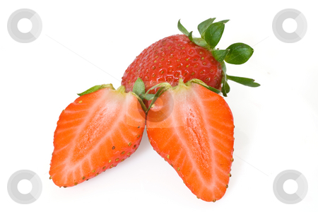 Strawberries cut in half stock photo, Two strawberries, one cut in half, isolated on white background with clipping path by ANTONIO SCARPI