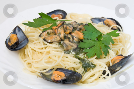 Spaghetti With Mussels stock photo, Spaghetti with mussels cooked with lightly garlic onion and parsley by ANTONIO SCARPI