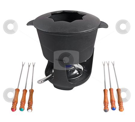 Cast iron fondue set stock photo, Characteristic cast iron set used for fondue or bourguignonne by ANTONIO SCARPI