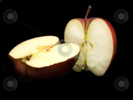 Sliced apple on black stock photo, Sliced apple on a black background by John Teeter