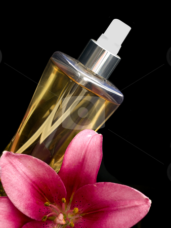 Perfume with flower stock photo, Perfume with flower on a black background by John Teeter