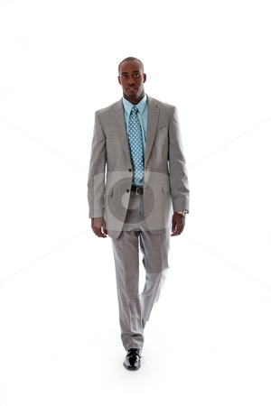 Handsome African business man stock photo, Handsome African American man in gray suit with smile walking, isolated by Paul Hakimata