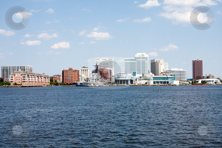 Norfolk, VA Skyline stock photo, The skyline of Norfolk, Virginia on a nice summer day seen from Craford Bay. Tall buildings and Nauticus marine terminal and museum, and the US Navy battleship USS Wisconsin (BB-64) in it's harbor port. by Paul Hakimata