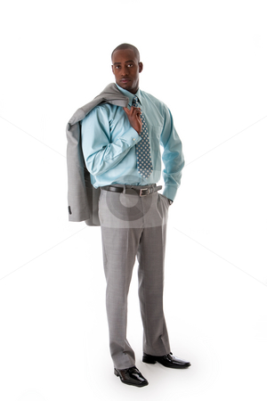 Handsome African business man stock photo, Handsome African American man in gray suit with smile standing with hand in pocket and blazer over shoulder, isolated by Paul Hakimata