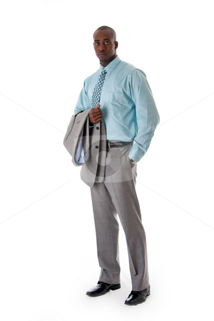 Handsome African business man stock photo, Handsome African American man in gray suit standing with hand in pocket and blazer over arm, isolated by Paul Hakimata