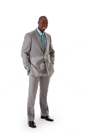Handsome African business man stock photo, Handsome African American man in gray suit with smile standing with hands in pocket, isolated by Paul Hakimata