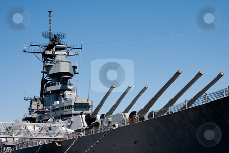 Turrets on navy battle ship stock photo, Turret barrels and control tower with radar on a US Navy military Iowa class battleship by Paul Hakimata