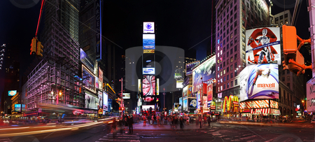 Times Square by night stock photo, Night scene of Times Square in Manhattan (New York City) with all the lit up billboards and advertisements by Paul Hakimata