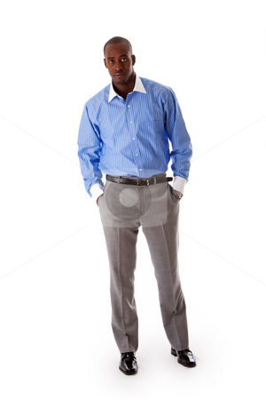 Handsome business man stock photo, Handsome African American business man standing tilted with hands in pocket, wearing blue pinstripe shirt and gray pants, isolated by Paul Hakimata