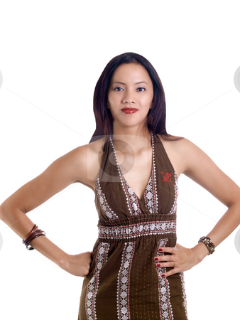 Young hispanic woman in brown dress hands on hips stock photo, Young latina woman hands on hips brown dress by Jeff Cleveland