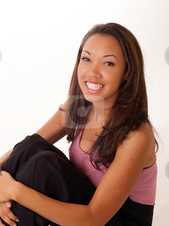 Smiling black woman with braces on upper teeth stock photo, Pretty young black woman with braces on upper teeth by Jeff Cleveland
