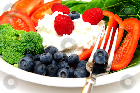 Fruit Salad stock photo, Closeuo of a cottage cheese salad with vegetables and berries including Raspberry, Blueberry, Red Bell Pepper, Broccoli, Tomato on a bed of Romain lettuce. by Lynn Bendickson