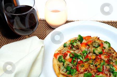 Gourmet Chicken And Veggie Pizza stock photo, Grilled teriyaki chicken with red bell pepper, garlic, mild jalapeno pepper, broccoli, tomato, sharp cheddar and fresh Parmesan cheese and a glass of red wine. by Lynn Bendickson