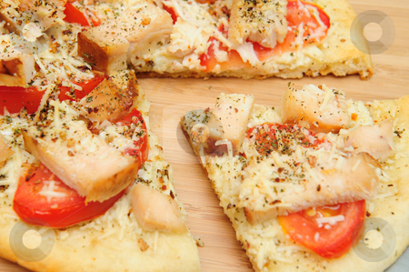 Chicken Pizza For One stock photo, A slice of grilled chicken, fresh tomatoes, garlic and grated Asiago cheese top this gournet pizza for one topped off with dried herbs and spices. by Lynn Bendickson