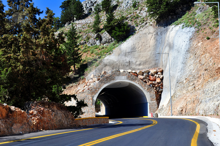Mountain tunnel stock photo, Travel photography: Mountain road passing through a tunnel in the island of   Crete. by Fernando Barozza